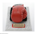 Boxing Collectibles:Autographs, Muhammad Ali Signed Boxing Glove. Offered here is a perfectright-handed Everlast boxing glove sporting a perfect black sha...