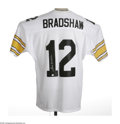 Football Collectibles:Others, Terry Bradshaw Signed Jersey. Excellent silver sharpie autograph is tagged on the rear numerals of the pristine white Pitts...