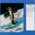 Autographs:Celebrities, Salyut 7 Space Station Color Photo Signed by Soyuz T-13 CosmonautsViktor Savinykh and Georgi Grechko. ...
