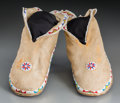 American Indian Art:Beadwork and Quillwork, A Pair of Osage Beaded Hide Moccasins... (Total: 2 Items)