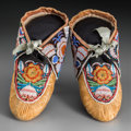 American Indian Art:Beadwork and Quillwork, A Pair of Iroquois Beaded Hide Moccasins... (Total: 2 Items)
