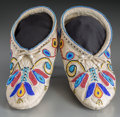 American Indian Art:Beadwork and Quillwork, A Pair of Santee Sioux Beaded Hide Moccasins... (Total: 2 Items)