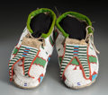 American Indian Art:Beadwork and Quillwork, A Pair of Assiniboine Beaded Hide Moccasins. ... (Total: 2 Items)