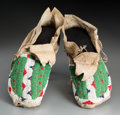 American Indian Art:Beadwork and Quillwork, A Pair of Sioux Beaded Hide Moccasins... (Total: 2 Items)