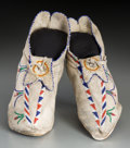 American Indian Art:Beadwork and Quillwork, A Pair of Apache Beaded Hide Moccasins... (Total: 2 Items)