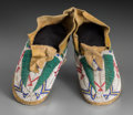 American Indian Art:Beadwork and Quillwork, A Pair of Cheyenne or Arapaho Child's Beaded Hide Moccasins...(Total: 2 Items)