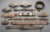 A Group of Twelve Turkoman or Tibetan Belts and Equestrian Accoutrements