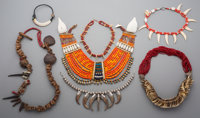 Six African Bone and Bead Necklaces  Seven African Bone, Tooth, and Beaded Necklaces