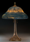 Decorative Arts, American:Lamps & Lighting, Classique Reverse Painted Glass and Bronze Tropical Night Table Lamp. Circa 1910. Painted to shade CLASSIQUE, ... (Total: 2 Items)