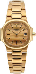 Estate Jewelry:Rings, Patek Philippe Lady's Nautilus Gold Watch. ...