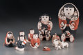 American Indian Art:Pottery, Ten Cochiti Polychrome Storyteller Figures. Vangie Suina... (Total:12 Items)