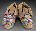 American Indian Art:Beadwork and Quillwork, A Pair of Plateau Pictorial Beaded Hide Moccasins... (Total: 2Items)