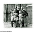 ELLIOT ERWITT (American b.1928) The Cast of the Misfits, 1960 Silver print 6.25in. x 7.5in. Signed in ink lower