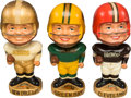 Football Collectibles:Others, 1965-68 Packers, Saints and Browns Real Face Nodders (3)....