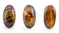 Gems:Cabochons, Tiger's Eye Cabochon Trio. Ord Ranges. Pilbara. WesternAustralia. 2.14 x 1.24 x 0.45 inches (5.44 x 3.16 x 1.15 cm).... (Total: 3 Items)