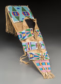 American Indian Art:Beadwork and Quillwork, A Crow Beaded Hide and Cloth Model Cradleboard. ...
