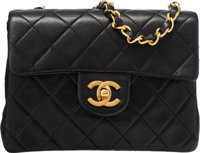 "Chanel Black Quilted Lambskin Leather Small Single Flap Bag Condition: 3 6.5"" Width x 5.5"" Height"