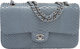 """Chanel Blue Python Medium Double Flap Bag Condition: 1 10"""" Width x 6"""" Height x 2.5"""" Depth This bag is don..."""