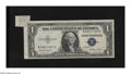 Error Notes:Attached Tabs, Fr. 1614 $1 1935E Silver Certificate. About Uncirculated.. Thisattached tab is rather large and contains the BEP's cutting ...