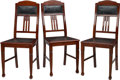Furniture : Continental, Three Jugendstil Oak and Leather Side Chairs, circa 1910-1920.39-1/2 h x 17-3/8 w x 17-3/4 d inches (100.3 x 44.1 x 45.1 cm...(Total: 3 Items)