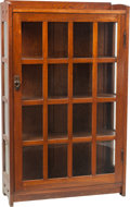 Furniture : American, A Gustav Stickley Oak and Glazed Single Door Bookcase, circa1912-1916. Marks: (branded Stickley mark to reverse). 58-1/2 h ...