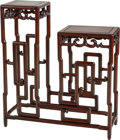 Asian:Chinese, A Chinese Carved Hardwood Two-Tiered Plant Stand. 38-1/4 h x 34 w x11-3/4 d inches (97.2 x 86.4 x 29.8 cm). ...