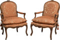 Furniture : Continental, A Pair of Louis XV-Style Carved Walnut Fauteuils. 36-1/2 h x 25-1/2w x 24 d inches (92.7 x 64.8 x 61.0 cm). ... (Total: 2 Items)
