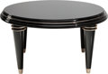 Furniture : Continental, An Art Deco Lacquered and Ebonized Wood Coffee Table. 17-1/2 incheshigh x 32 inches diameter (44.5 x 81.3 cm). PROPERTY F...