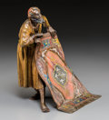 Decorative Arts, Continental, A Bergman-Style Cold Painted Bronze Figure: Rug Seller. 7-3/4 h x 6-1/2 w x 6 d inches (19.7 x 16.5 x 15.2 cm)...