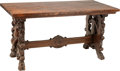 Furniture : Continental, A Baroque-Style Carved Walnut Figural Trestle Table, 19th century.30-3/4 h x 60 w x 30-1/8 d inches (78.1 x 152.4 ...
