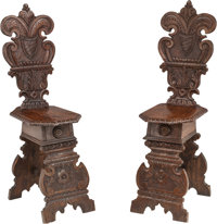 A Pair of Renaissance Revival-Style Carved Walnut Hall Chairs 43 h x 12-1/2 w x 17 d inches (109.2 x 31.8 x 43.2 c