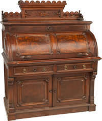 An American Renaissance Revival Carved Oak and Walnut Cylinder Desk in the Style of Wooten, late 19th century 59-1