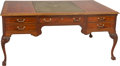 Furniture : Continental, A Continental Carved Walnut and Fruitwood Inlaid Desk, 19thcentury. 32 h x 71 w x 48 d inches (81.3 x 180.3 x 121....