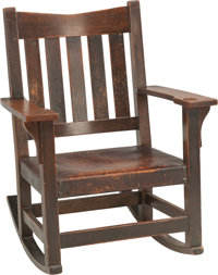 A Gustav Stickley Arts & Crafts Oak and Leather Rocking Chair, early 20th century 34 h x 25-3/4 w x 28-1/4 d inche...