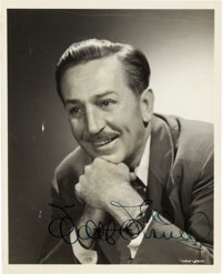 Walt Disney Signed Photograph and In-House Biography (Walt Disney, c. 1950).... (Total: 2 Items)
