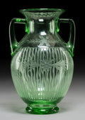Art Glass:Steuben, A Steuben Green Glass Handled Vase with Intaglio Decoration, Corning, New York. 10 inches high x 7 inches diameter (25.4 x 1...