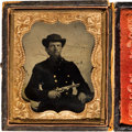 Photography:Tintypes, [Civil War]. Tintype of an Unidentified Soldier with a Revolver....