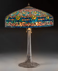Art Glass:Other , An American Tiffany Studios-Style Leaded Glass Table Lamp on TreeTrunk-Form Bronze Base, 20th century. 24 inches high x 18-...(Total: 2 Items)