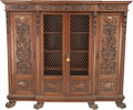 Furniture : Continental, A Renaissance Revival Carved Oak Three-Section Bookcase, late 19thcentury. 69-1/8 h x 81 w x 19 d inches (175.6 x 205.7 x 4...