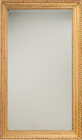 Furniture : Continental, A Neoclassical Carved Giltwood Mirror. 57-1/4 h x 35-1/8 w x 3-1/2d inches (145.4 x 89.2 x 8.9 cm). PROPERTY FROM THE RIT...