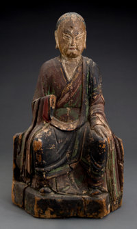 A Chinese Carved and Polychromed Wood Seated Buddha Figure 21-1/4 inches high (54.0 cm)