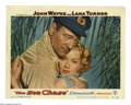 """Movie Posters:War, The Sea Chase (Warner Brothers, 1955). (2) Lobby Card (11"""" X 14""""). John Wayne plays a Prussian sea captain, who despite his ... (2 Items)"""