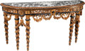 Furniture : Continental, A Continental Carved, Ebonized, and Giltwood Console with FauxTortoiseshell Veneer and Inlaid Marble Top. 35 h x 71-1/2 w x...
