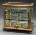 Other, A Glass and Gilt Metal Mounted Cabinet. 12 inches high x 13-1/2 inches wide x 10-1/4 inches deep (30.5 x 34.3 x 26.0 cm). ...