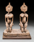 African, An African Carved Wood Sculpture of Kneeling Male and FemaleFigures. 16-3/4 h x 14 w x 7-3/4 d inches (42.5 x 35.6 x 19.7 c...