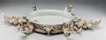 Decorative Arts, Continental, A Large Oval Silvered Bronze Centerpiece. 5 inches high x 33-1/2inches wide x 18-1/2 inches deep (12.7 x 85.1 x 47.0 cm). ...