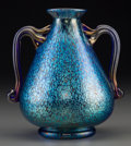 Art Glass:Loetz, A Loetz Iridescent Blue Glass Handled Vase, circa 1900. Marks:CZECHO-SLOVAKIA. 7 inches high (17.8 cm). ...