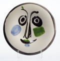 Sculpture, Pablo Picasso (1881-1973). Visage No. 197, 1963. Earthenware ceramic plate painted in colors with glazing . 9-3/4 inch d...
