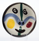 Pablo Picasso (1881-1973) Visage No. 0, 1963 White earthenware ceramic plate with colored engobe and glaze 9-7/8 inch