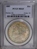 Morgan Dollars: , 1889 $1 MS65 PCGS. Cobalt-blue and russet toning bathe lustroussurfaces. Sharply struck, with no significant marks....